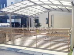 施工例画像:電動跳ね上げ式門扉 LIXILリクシル 木製調ワイドオーバードアS3型 横2台用 アップゲート