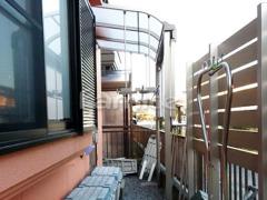 施工例画像:雨除け屋根 LIXILリクシル スピーネ 1階用 R型アール屋根 物干し