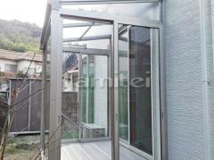 施工例画像:ガーデンルーム YKKAP ソラリア サンルーム F型フラット屋根 物干し 網戸(側面 サイド)