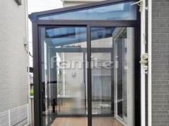 施工例画像:ガーデンルーム YKKAP ソラリア サンルーム F型フラット屋根 物干し 網戸(両側面)