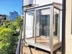 施工例画像:ガーデンルーム YKKAP ソラリア サンルーム F型フラット屋根 物干し