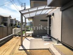 施工例画像:テラス屋根 カーポート LIXILリクシル ネスカR 1台用(単棟) R型アール屋根 タイルデッキ アンビスレート300角 AS-14