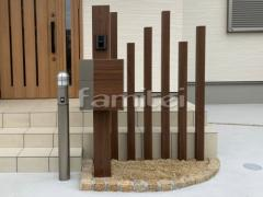 施工例画像:機能門柱 LIXILリクシル 木製調FW お客様ご支給品 インターホン ポールライト取付